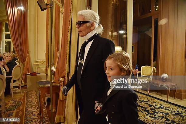 Karl Lagerfeld and Hudson Kroenig walk the runway during Chanel Collection des Metiers d'Art 2016/17 Paris Cosmopolite show on December 6 2016 in...