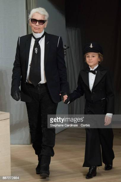 Karl Lagerfeld and Hudson Kroenig walk the runway during the Chanel Collection Metiers d'Art Paris Hamburg 2017/18 at the Elbphilharmonie on December...