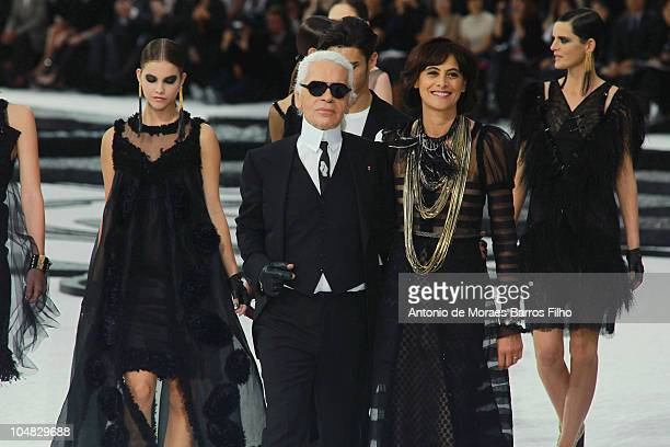 Karl Lagerfeld and Ines de la Fressange walk the runway during the Chanel Ready to Wear Spring/Summer 2011 show during Paris Fashion Week at Grand...
