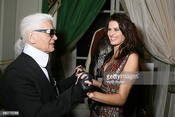 Karl Lagerfeld and Isabeli Fontana attend Der Berliner Mode Salon supported by MercedesBenz Cocktail as part of Paris fashion Week at Hotel de...