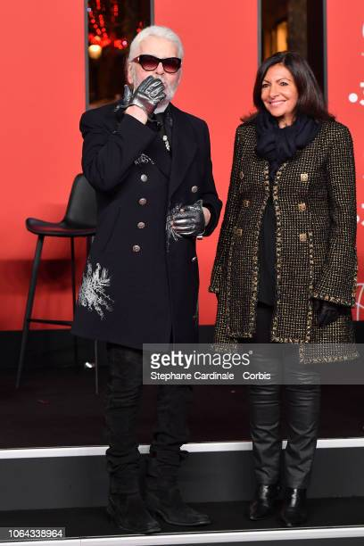 Karl Lagerfeld and Mayor of Paris Anne Hidalgo attend the Christmas Lights Launch On The Champs Elysees on November 22 2018 in Paris France