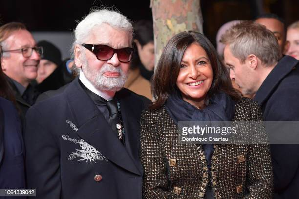 Karl Lagerfeld and Mayor of Paris Anne Hidalgo attend the Christmas Lights Launch On The Champs Elysees In Paris on November 22, 2018 in Paris,...