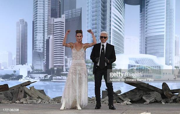 Karl Lagerfeld and model Erin Wasson walk the runway during Chanel show as part of Paris Fashion Week HauteCouture Fall/Winter 20132014 at Grand...