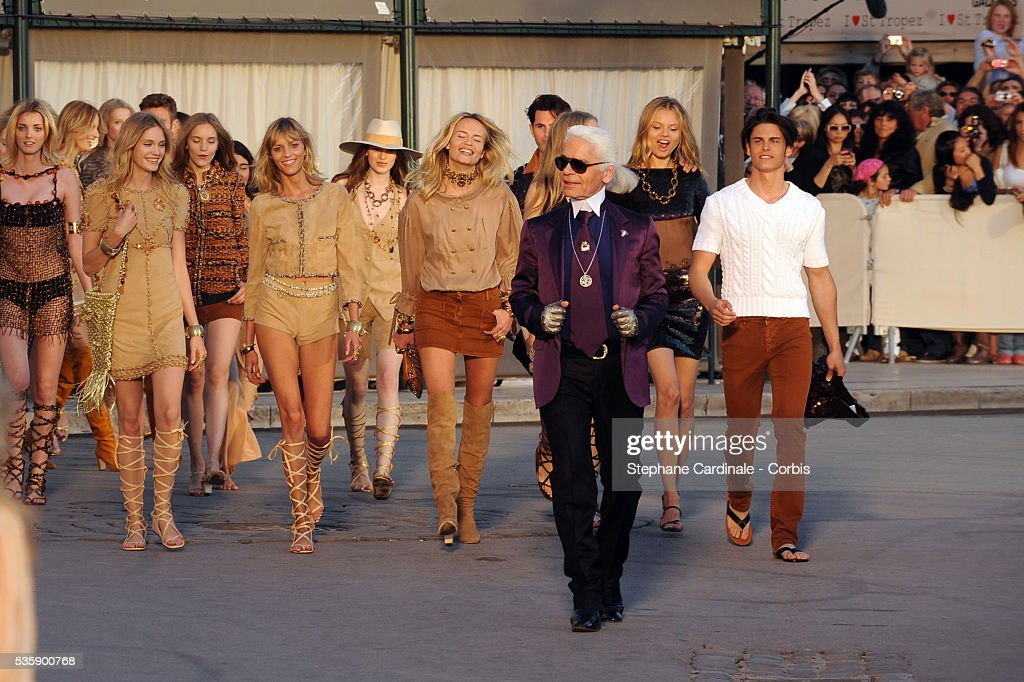 Karl Lagerfeld and models on the runway during the Chanel Cruise Collection Presentation in Saint Tropez