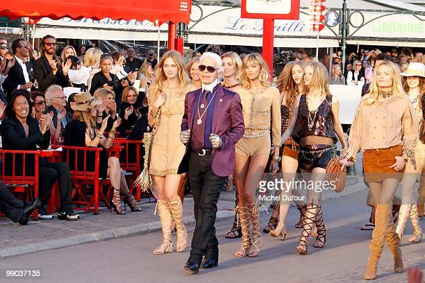Karl Lagerfeld and models walk the runway at the Chanel Cruise Collection Presentation on May 11, 2010 in Saint-Tropez, France.