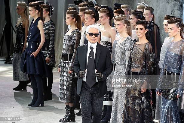 Karl Lagerfeld and models walk the runway during Chanel show as part of Paris Fashion Week HauteCouture Fall/Winter 20132014 at Grand Palais on July...