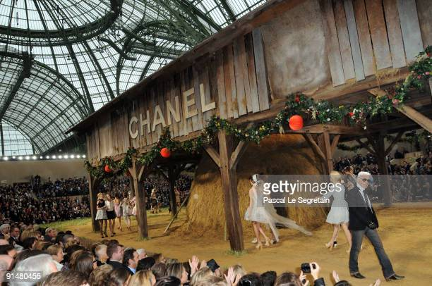Karl Lagerfeld and models walk the runway during the Chanel Pret a Porter show as part of the Paris Womenswear Fashion Week Spring/Summer 2010 at...