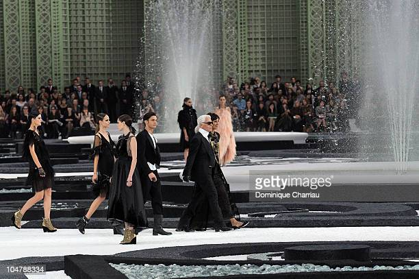 Karl Lagerfeld and Models walk the runway during the Chanel Ready to Wear Spring/Summer 2011 show during Paris Fashion Week at Grand Palais on...