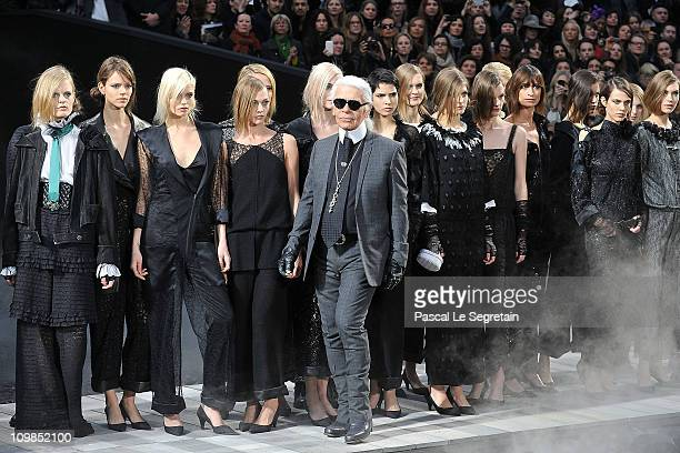 Karl Lagerfeld and models walk the runway during the Chanel Ready to Wear Autumn/Winter 2011/2012 show during Paris Fashion Week at Grand Palais on...
