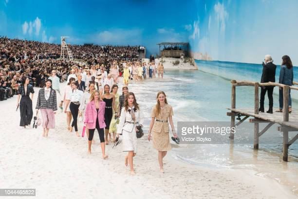 Karl Lagerfeld and models walk the runway during the finale of the Chanel show as part of the Paris Fashion Week Womenswear Spring/Summer 2019 on...