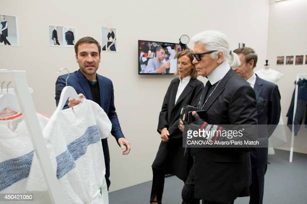 Karl Lagerfeld and Phoebe Philo members of the jury are photographed for Paris match with the canadian stylist Chris Gelinas at the headquarters of...