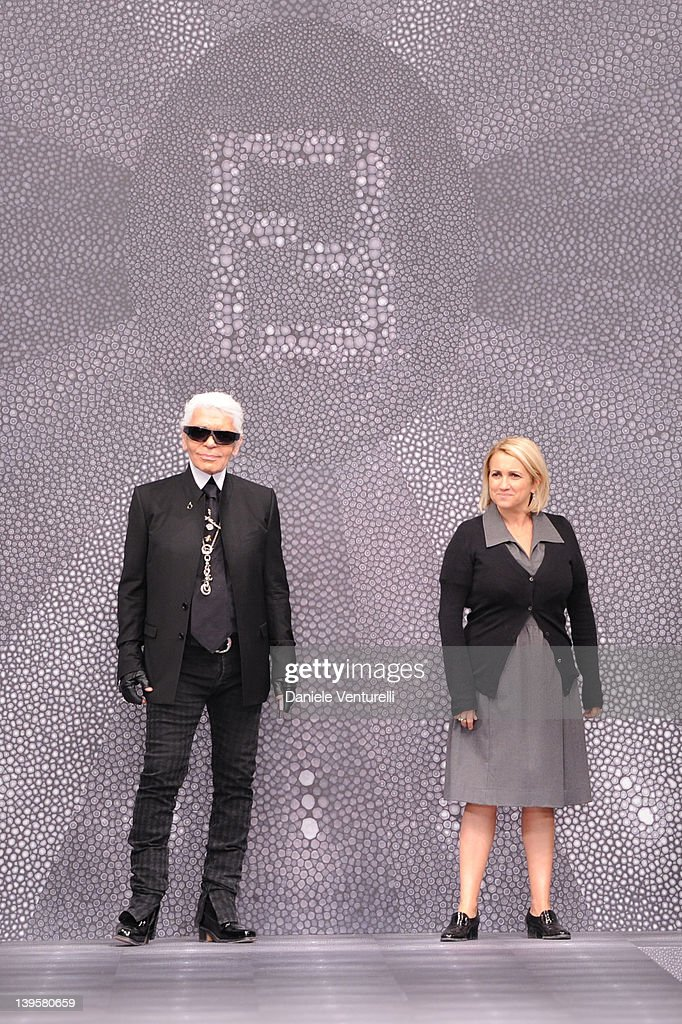 Karl Lagerfeld and Silvia Fendi aknowledge the applause of the public after the Fendi Autumn/Winter 2012/2013 fashion show as part of Milan Womenswear Fashion Week on February 23, 2012 in Milan, Italy.