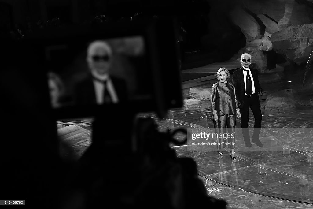 Karl Lagerfeld and Silvia Venturini Fendi acknowledge the applause of the public after the Fendi Roma 90 Years Anniversary fashion show at Fontana di Trevi on July 7, 2016 in Rome, Italy.