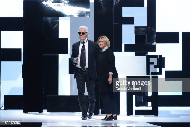 Karl Lagerfeld and Silvia Venturini Fendi aknowledge the applause of the public after the Fendi fashion show during Milan Fashion Week Womenswear...