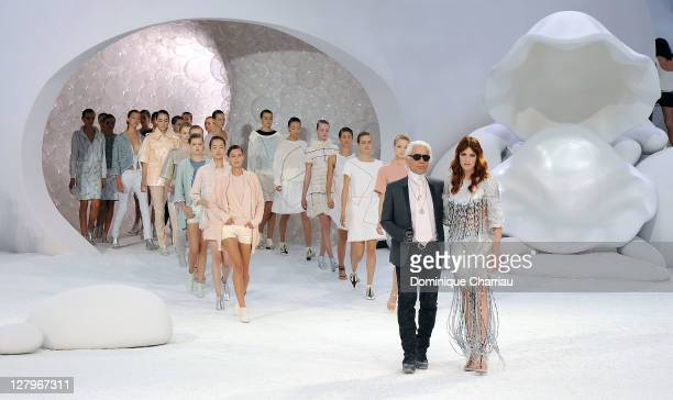 Karl Lagerfeld and Singer Florence Welch walk the runway during the Chanel Ready to Wear Spring / Summer 2012 show during Paris Fashion Week at Grand...