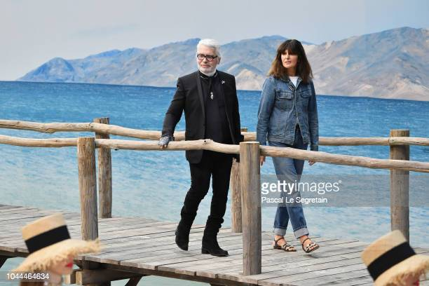 Karl Lagerfeld and Virginie Viard walk the runway during the Chanel show as part of the Paris Fashion Week Womenswear Spring/Summer 2019 on October 2...
