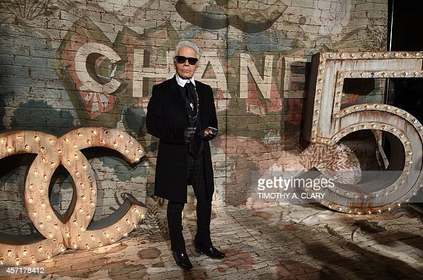 Karl Lagerfeld arrives for the Chanel dinner celebrating the debut screening of N°5 The Film by Baz Luhrmann in New York October 13 2014 AFP PHOTO /...