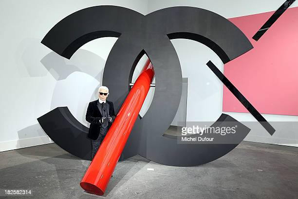 Karl Lagerfeld attends the Chanel show as part of the Paris Fashion Week Womenswear Spring/Summer 2014 on October 1 2013 in Paris France