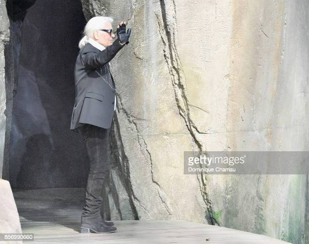Karl Lagerfeld blows a kiss on the runway during the Chanel show as part of the Paris Fashion Week Womenswear Spring/Summer 2018 on October 3 2017 in...