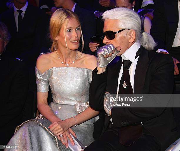 Karl Lagerfeld chats with Claudia Schiffer at the ELLE Fashion Star award ceremony during Mercedes Benz Fashion week Spring/Summer 2009 at the...