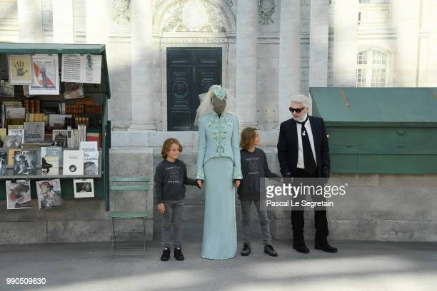 Karl Lagerfeld greets the audience on the runway during the Chanel Haute Couture Fall Winter 2018/2019 show as part of Paris Fashion Week on July 3...