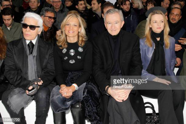 Karl Lagerfeld Helene Arnault Bernard Arnault Chairman and CEO of LVMH Moet Hennessy Louis Vuitton and Delphine Arnault attend the Dior Homme Men...