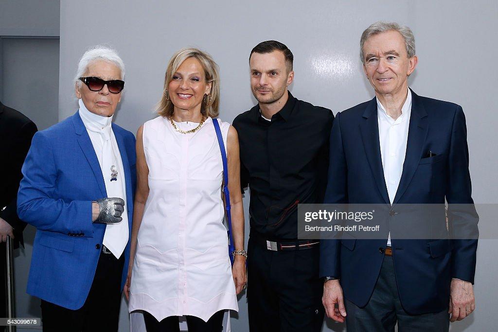 Karl Lagerfeld, Helene Arnault, Fashion designer Kris Van Assche and Owner of LVMH Luxury Group Bernard Arnault pose Backstage after the Dior Homme Menswear Spring/Summer 2017 show as part of Paris Fashion Week on June 25, 2016 in Paris, France.