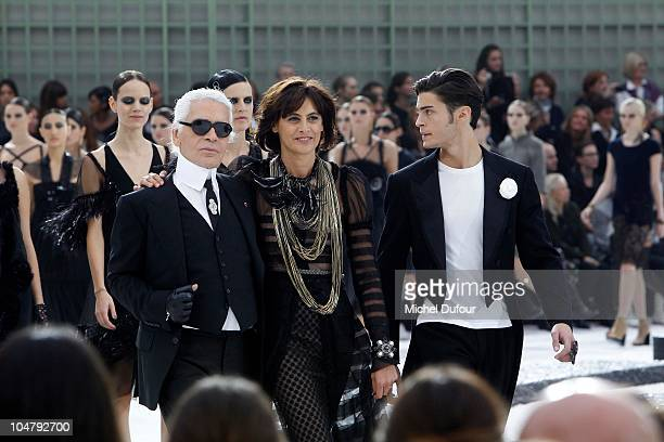 Karl Lagerfeld Ines de la Fressange and Baptiste Giabiconi walk the runway during the Chanel Ready to Wear Spring/Summer 2011 show during Paris...