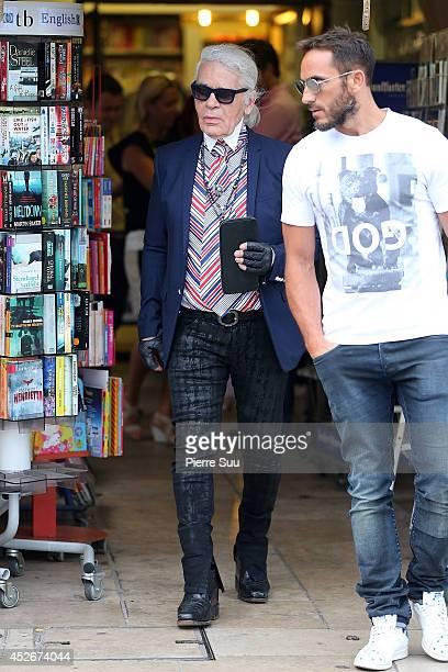 FRANCE Karl Lagerfeld is seen in the port on July 25 2014 in Saint Tropez France