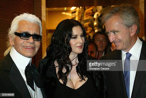 Karl Lagerfeld Monica Bellucci and Bernard Arnault attend the launch of the Palazzo Fendi Italian Store on May 18 2005 in Rome Italy