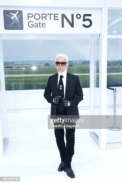 Karl Lagerfeld poses after the Chanel show as part of the Paris Fashion Week Womenswear Spring/Summer 2016 on October 6 2015 in Paris France