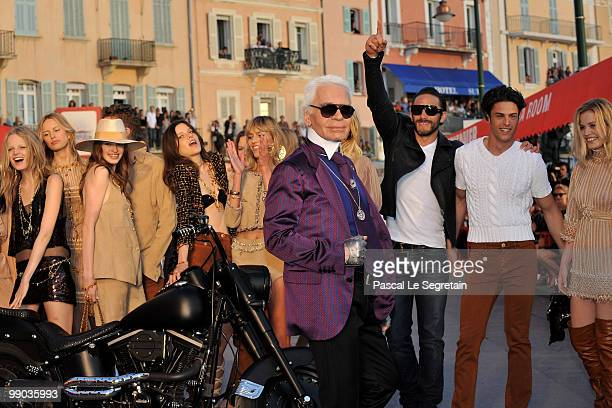 Karl Lagerfeld poses with models during the Chanel Cruise Collection Presentation on May 11 2010 in SaintTropez France