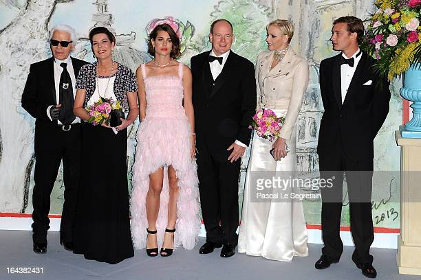 Karl Lagerfeld Princess Caroline of Hanover Charlotte Casiraghi Prince Albert II of Monaco Princess Charlene of Monaco and Pierre Casiraghi attend...