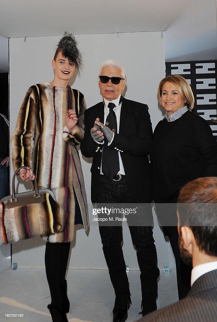 Karl Lagerfeld (C), Silvia Venturini Fendi (R) and a model attend the Fendi fashion show as part of Milan Fashion Week Womenswear Fall/Winter 2013/14 on February 21, 2013 in Milan, Italy.