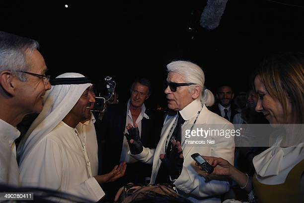 Karl Lagerfeld speaks to Sheikh Ahmed bin Saeed Al Maktoum after the Chanel Cruise Collection 2014/2015 at The Island on May 13 2014 in Dubai United...