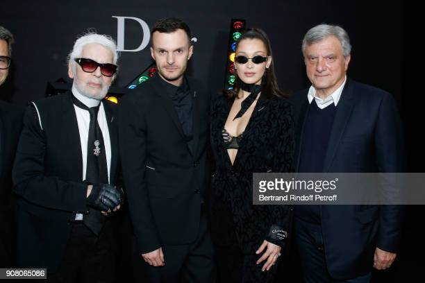 Karl Lagerfeld Stylist of Dior Men Kris Van Assche Bella Hadid and Outgoing CEO of Dior Sidney Toledano pose after the Dior Homme Menswear...
