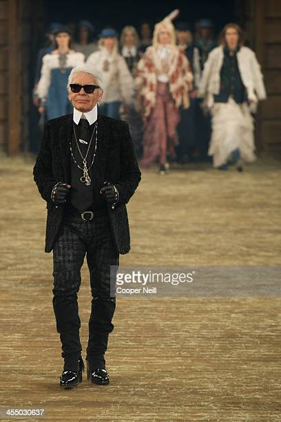 Karl Lagerfeld walks the runway after the Chanel Metiers d'Art Show at Fair Park on December 10 2013 in Dallas Texas