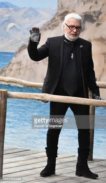Karl Lagerfeld walks the runway during the finale of the Chanel show as part of the Paris Fashion Week Womenswear Spring/Summer 2019 on October 2...