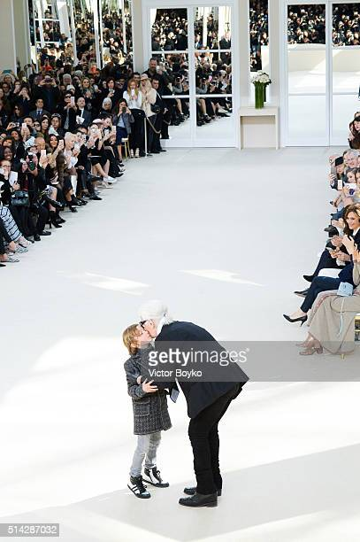 Karl Lagerfeld walks the runway with his godson Hudson Kroenig during the Chanel show as part of the Paris Fashion Week Womenswear Fall/Winter...