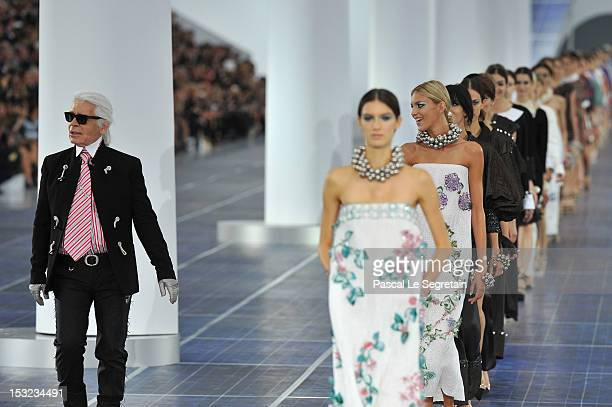 Karl Lagerfeld walks the runway with the Chanel models during the Chanel Spring / Summer 2013 show as part of Paris Fashion Week at Grand Palais on...