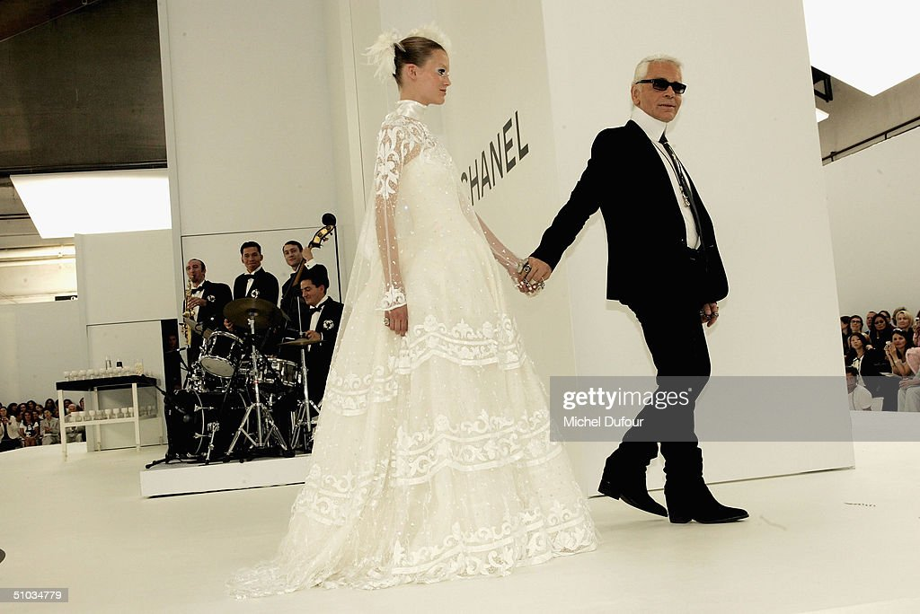 Karl Lagerfeld with a model bride on stage at the Chanel Spring/Summer 2005 Fashion Show during Paris Fashion Week on July 7, 2004 in Paris, France.
