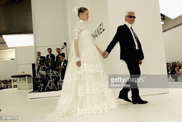 Karl Lagerfeld with a model bride on stage at the Chanel Spring/Summer 2005 Fashion Show during Paris Fashion Week on July 7 2004 in Paris France