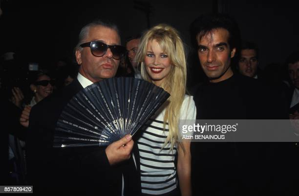 Karl Lagerfeld with Claudia Schiffer and David Copperfield during Chanel show at Haute Couture Fall Winter 19941995 on July 19 1994 in Paris France