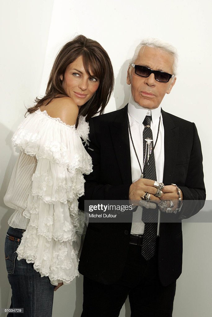 Karl Lagerfeld with Elizabeth Hurley attend the Chanel Spring/Summer 2005 Fashion Show during Paris Fashion Week on July 7, 2004 in Paris, France.