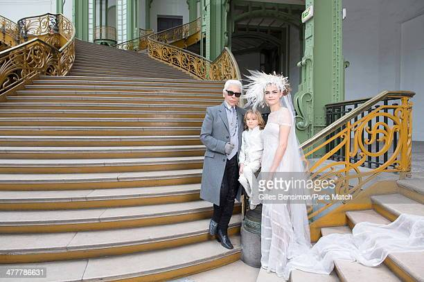 Karl Lagerfeld with his godson Hudson and Cara Delevingne are photographed for Paris Match on January 21 2014 in Paris France