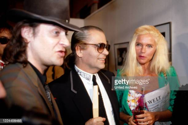 Karl Lagerfeld with singer Udo Lindenberg and Gunilla von Bismarck at the opening of his photography exhibition Parade at Museum fuer moderne Kunst...