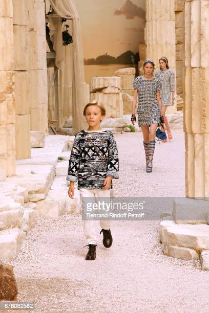 Karl Lagerfeld's godson Hudson Kroenig walks the runway during the Chanel Cruise 2017/2018 Collection Show at Grand Palais on May 3 2017 in Paris...