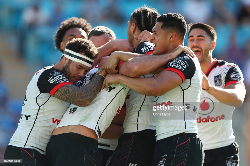 Karl Lawton of the Warriors celebrates a try with team mates during the round 20 NRL match between the Gold Coast Titans and the New Zealand Warriors at Cbus Super Stadium on July 29, 2018 in Gold Coast, Australia.
