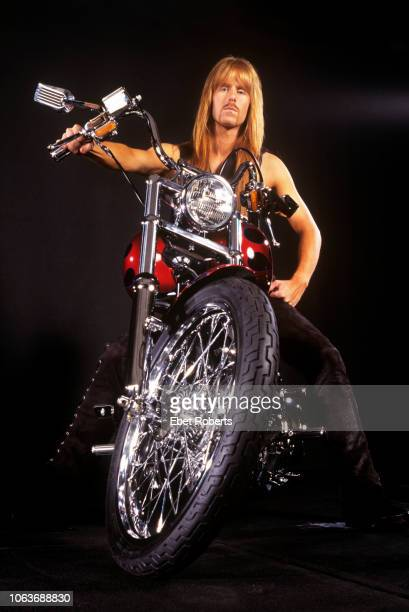 Karl Logan of Manowar posing on a motorbike during a studio shoot in Auburn New York on July 161996
