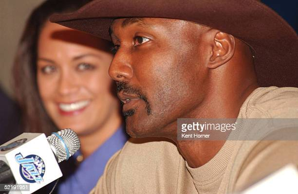 Karl Malone along with wife Kay announces his retirement from the NBA on February 13 2005 at the Delta Center in Salt Lake City Utah NOTE TO USER...